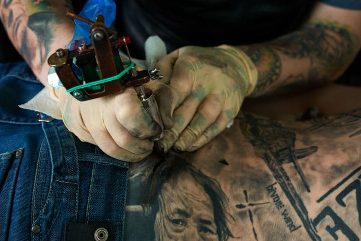 Working hands of tattoo master